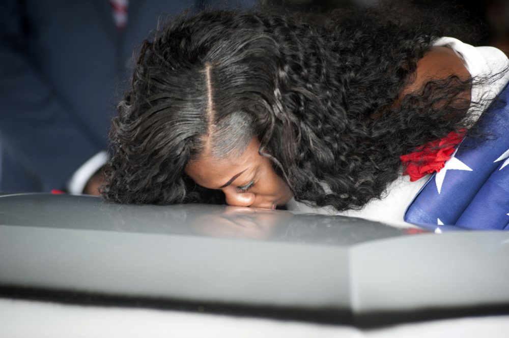 Myeshia Johnson kisses the casket of her husband Army Sgt. La David Johnson during his burial service at the Memorial Gardens East cemetery on Oct. 21, 2017, in Hollywood, Fla. (Gaston De Cardenas/AFP/Getty Images)