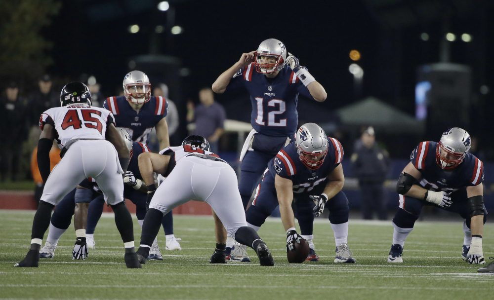 New England Patriots quarterback Tom Brady (12) calls signals at the line of scrimmage during the first half of an NFL football game against the Atlanta Falcons. (Steven Senne/AP)