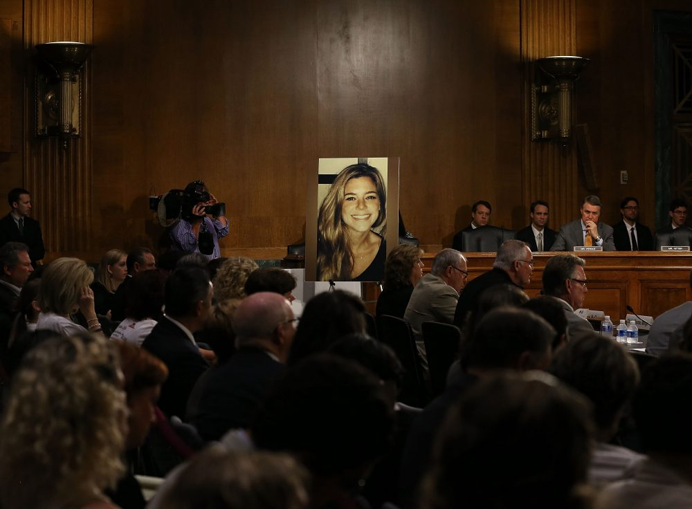 "A large photo of Kathryn ""Kate"" Steinle who was killed by an immigrant living in the U.S. illegally, is shown while her dad Jim Steinle testifies during a Senate Judiciary Committee hearing on Capitol Hill, July 21, 2015 in Washington, D.C. (Mark Wilson/Getty Images)"