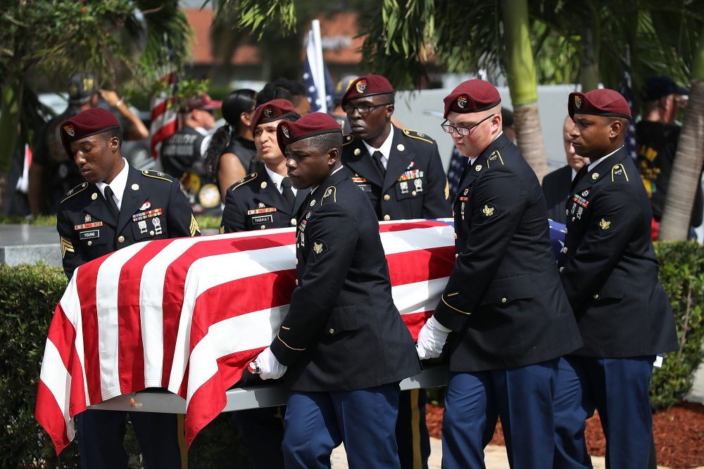 U.S. military honor guards carry the casket of U.S. Army Sgt. La David Johnson during his burial service at the Memorial Gardens East cemetery on Oct. 21, 2017 in Hollywood, Fla. Johnson and three other American soldiers were killed in an ambush in Niger on Oct. 4. (Joe Raedle/Getty Images)