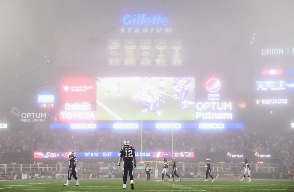 Fog at the recent Patriots-Falcons game ushered in Halloween season. (Billie Weiss/Getty Images)
