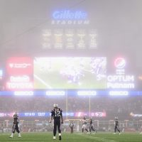 Fog falls on the Patriots-Falcons game in a haunting Super Bowl rematch. (Billie Weiss/Getty Images)