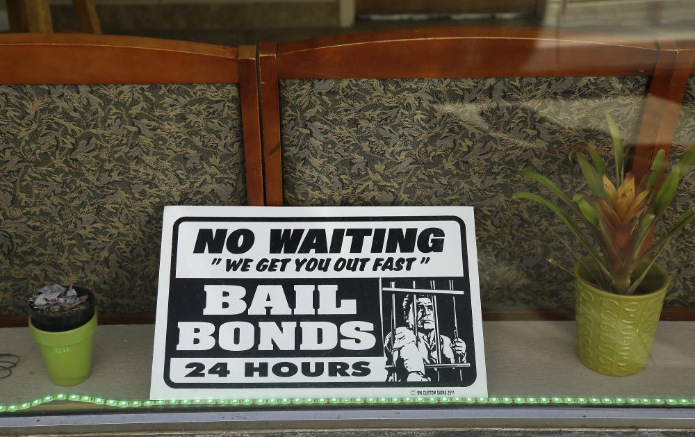 In this photo taken Wednesday, Dec. 23, 2015, a sign is seen in the window of a bail bonds office across from the Hall of Justice in San Francisco. (Eric Risberg/AP)