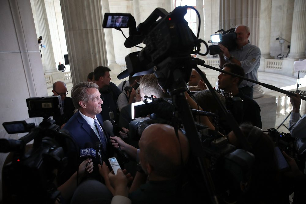 Sen. Jeff Flake, R-Ariz., speaks to reporters on Capitol Hill after announcing he will not seek re-election Oct. 24, 2017 in Washington. Flake announced that he will leave the Senate after his term ends in 14 months. (Win McNamee/Getty Images)