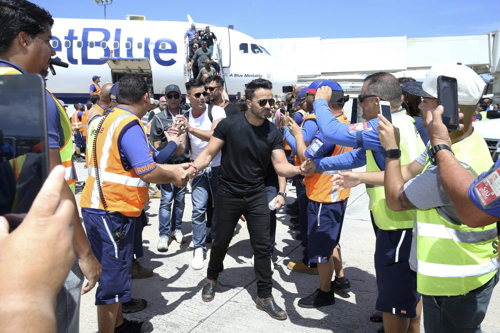 Singers Luis Fonsi, Ricky Martin and other Latin celebrities greet JetBlue crewmembers upon arrival at Luis Muñoz Marín International Airport in San Juan, Puerto Rico. The mission was part of a #100x35JetBlue special relief effort with JetBlue aimed at raising awareness and delivering aid to the people of Puerto Rico. (JetBlue via AP Images)