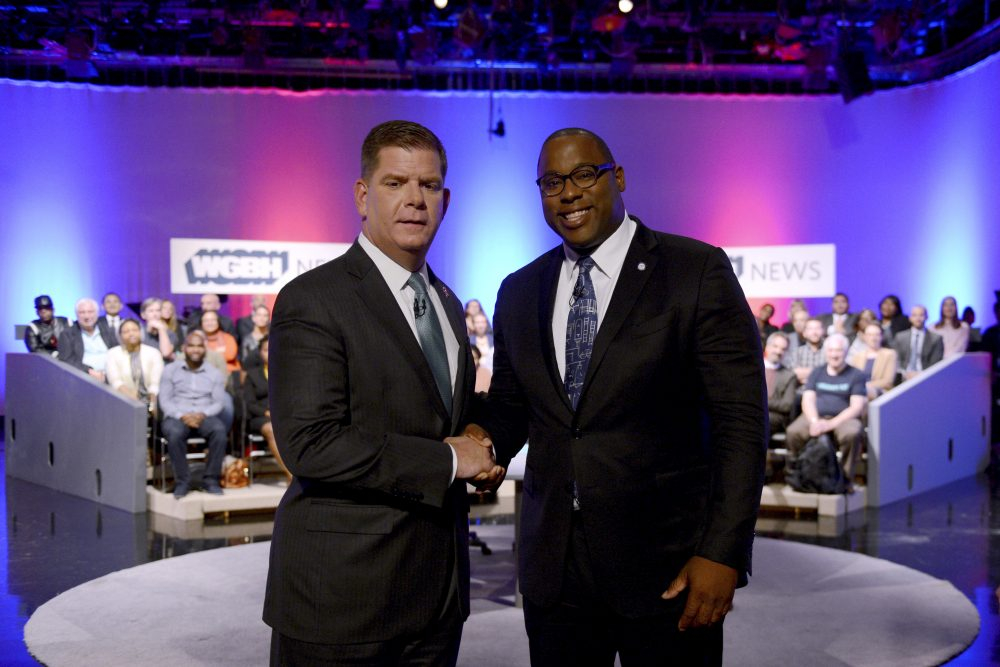 Boston Mayor Marty Walsh, left, and City Councilor Tito Jackson, right, shake hands after a mayoral debate at the WGBH in Boston on Tuesday. (Meredith Nierman/WGBH News via AP, Pool)