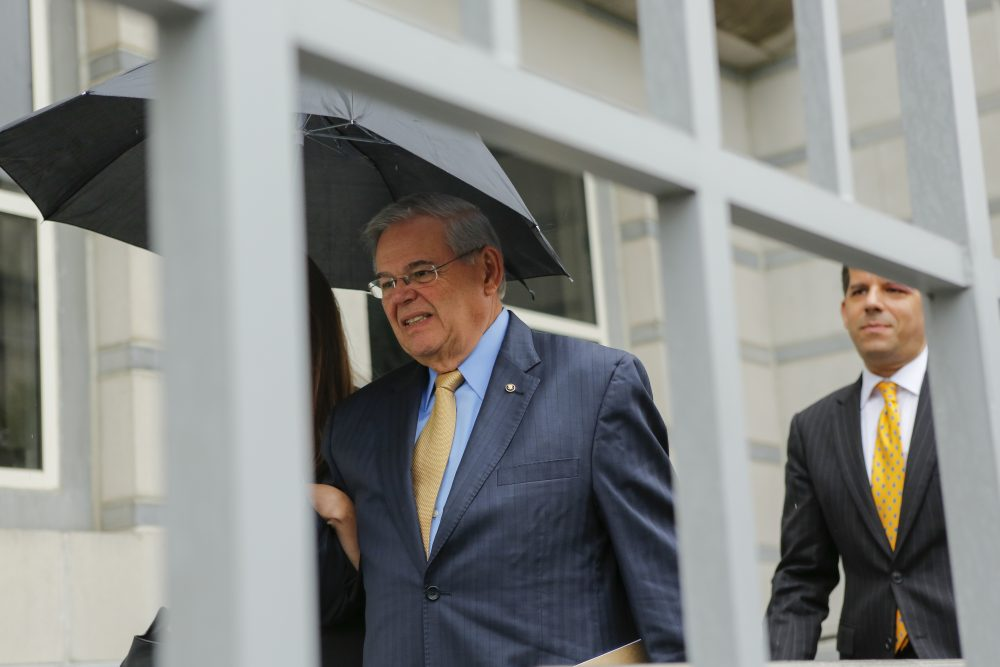U.S. Sen. Robert Menendez, D-N.J. (left) exits federal court on the first day of his trial on corruption charges on Sept. 6, 2017 in Newark, N.J. (Eduardo Munoz Alvarez/Getty Images)