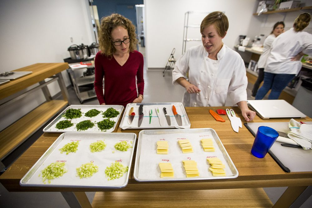 In the new Tasting and Testing kitchen, Brianna Palma and Kate Shannon review a test on chef knives for kids. (Jesse Costa/WBUR)