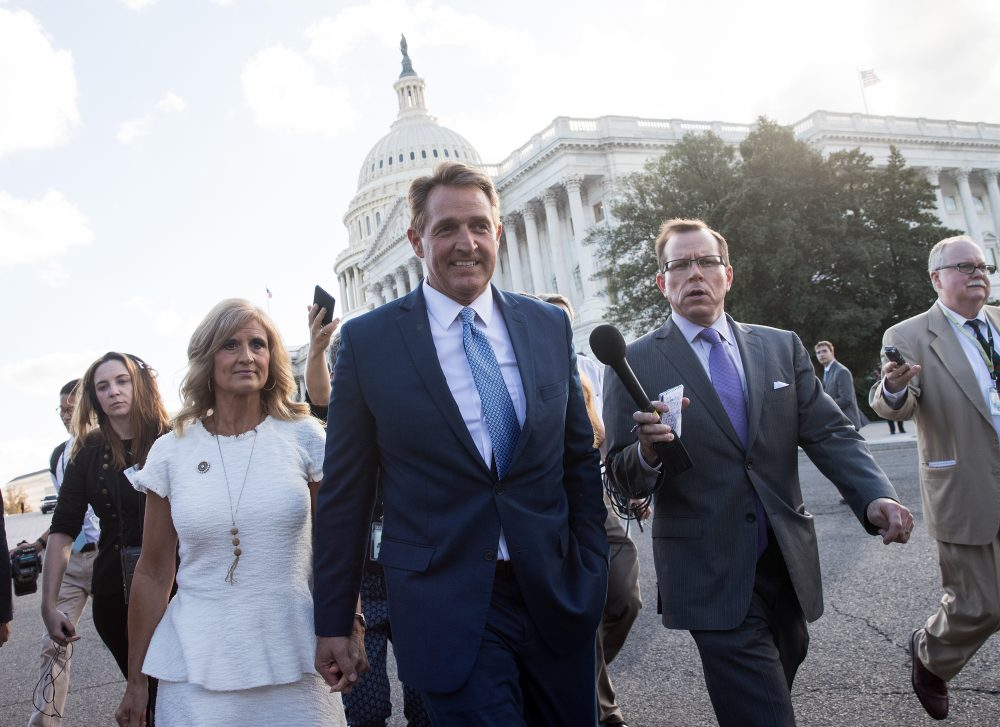 Sen. Jeff Flake (R-Ariz.) and his wife Cheryl Flake leave the U.S. Capitol as they are trailed by reporters, Oct. 24, 2017 in Washington, D.C. Flake announced that he will not be seeking re-election and he will leave the Senate after his term ends in 2018. (Drew Angerer/Getty Images)