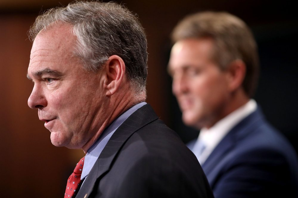 Sen. Tim Kaine (D-Va.) and Sen. Jeff Flake (R-Ariz.) talk about their introduction of a new Authorization for the Use of Military Force (AUMF) against the Islamic State of Iraq and Syria (ISIS), al-Qaeda and the Taliban during a news conference at the U.S. Capitol May 25, 2017 in Washington, D.C. (Chip Somodevilla/Getty Images)