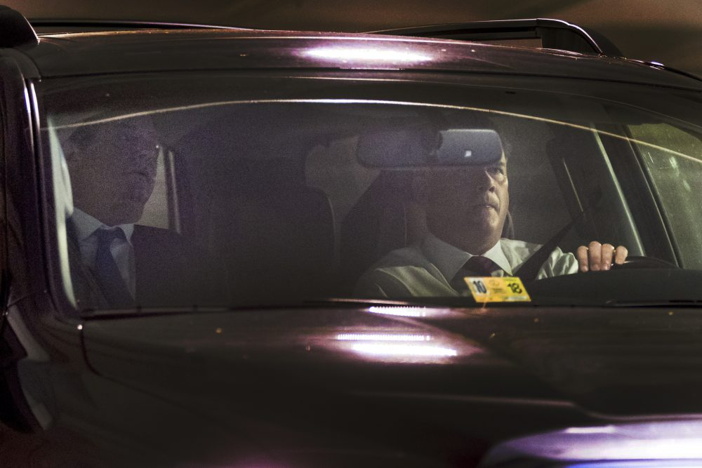 Former Trump Campaign Chairman Paul Manafort, left, leaves his home in Alexandria, Va., Monday, Oct. 30, 2017. Manafort and a former business associate, Rick Gates, have been told to surrender to federal authorities Monday, according to reports and a person familiar with the matter. (Andrew Harnik/AP)
