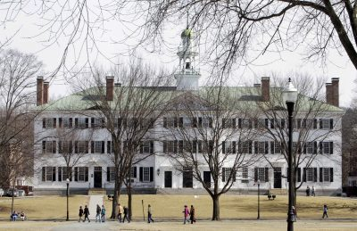 Students walk across the Dartmouth College campus green in Hanover, N.H. in 2012. (Jim Cole/AP file)