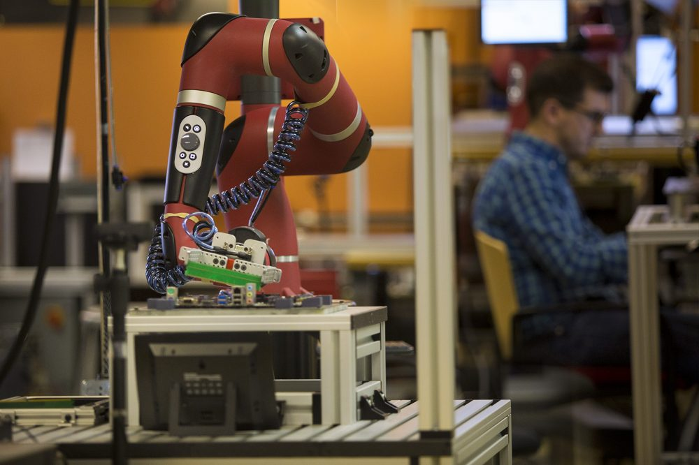 A robot and a human (Jesse Costa/WBUR)