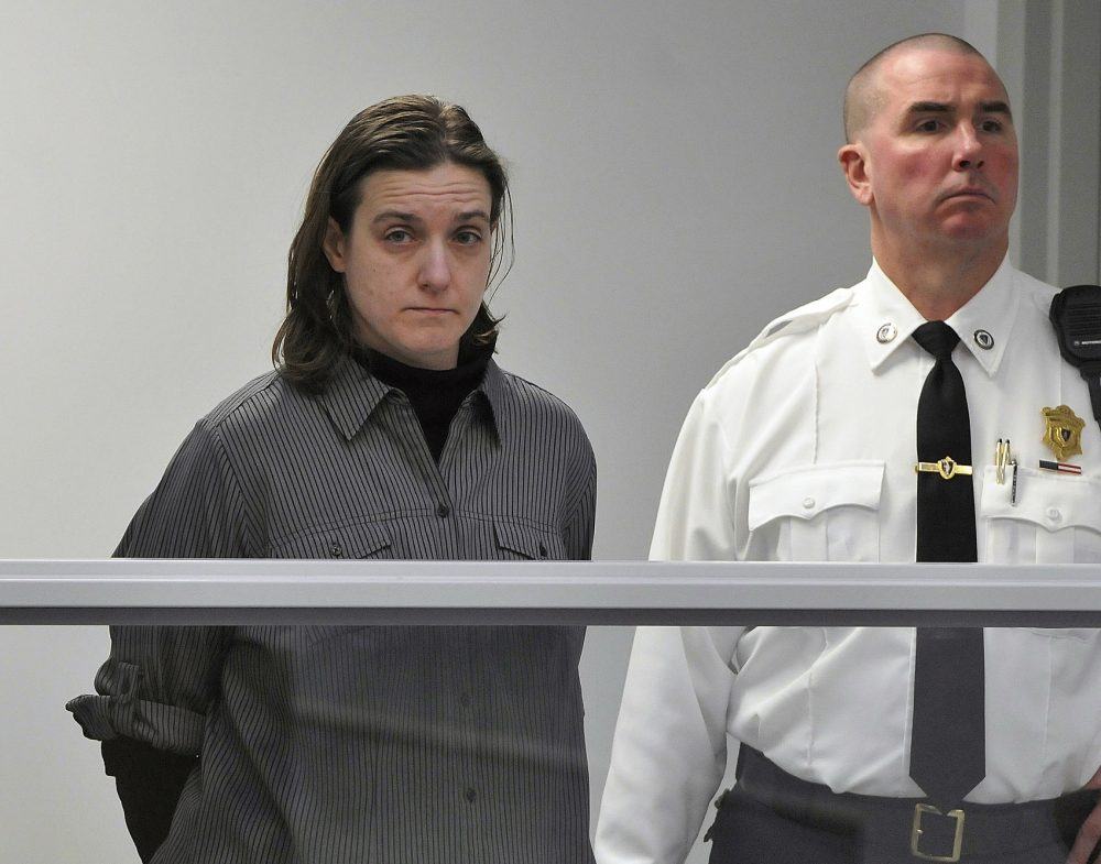 FILE - In this Jan. 22, 2013, file photo, Sonja Farak, left, stands during her arraignment at Eastern Hampshire District Court in Belchertown, Mass. Assistant Hampden County District Attorney Bethany Lynch said Tuesday, Oct. 31, 2017, in a Massachusetts Supreme Judicial Court hearing, that approximately 4,300 cases have been connected to evidence tested by Farak, who was convicted in 2014 of stealing drugs and tampering with evidence at the lab. Lynch said her office is deciding which cases it will agree to dismiss and which to retry. (Don Treeger/The Republican via AP, Pool, File)