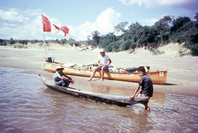 Dana and two children on the Orinoco River in Venezuela. (Don Starkell)