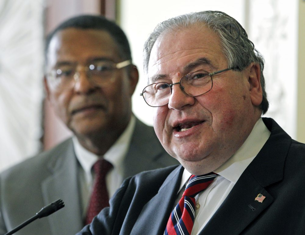 House Speaker Robert DeLeo speaks as then-Supreme Judicial Court Chief Justice Roderick Ireland listens in this 2011 file photo. Ireland is now advising DeLeo's House on criminal justice legislation. (Elise Amendola/AP)