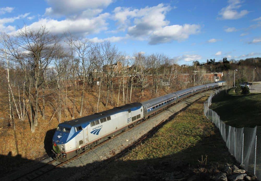 In this Dec. 8, 2011 photo, the Amtrak Downeaster travels through Portland, Maine. (Robert F. Bukaty/AP)