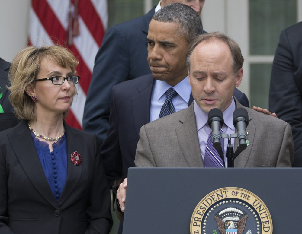 Barden speaks in the Rose Garden of the White House on April 17, 2013, as President Obama and former Rep. Gabby Giffords look on. (Carolyn Kaster/AP)