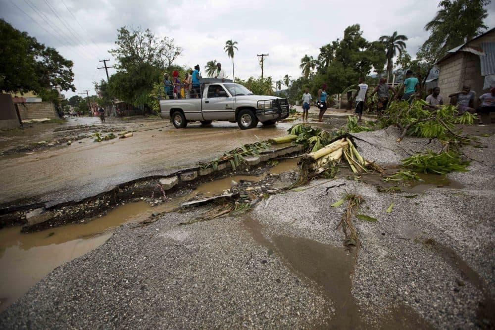 A truck negotiates a road damaged by Hurricane Matthew, in Petit Goave, Haiti, on Oct. 5, 2016. (Dieu Nalio Chery/AP)
