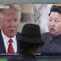 In this Thursday, Aug. 10, 2017, file photo, a man watches a television screen showing U.S. President Donald Trump, left, and North Korean leader Kim Jong Un during a news program at the Seoul Train Station in Seoul, South Korea. (Ahn Young-joon/AP)