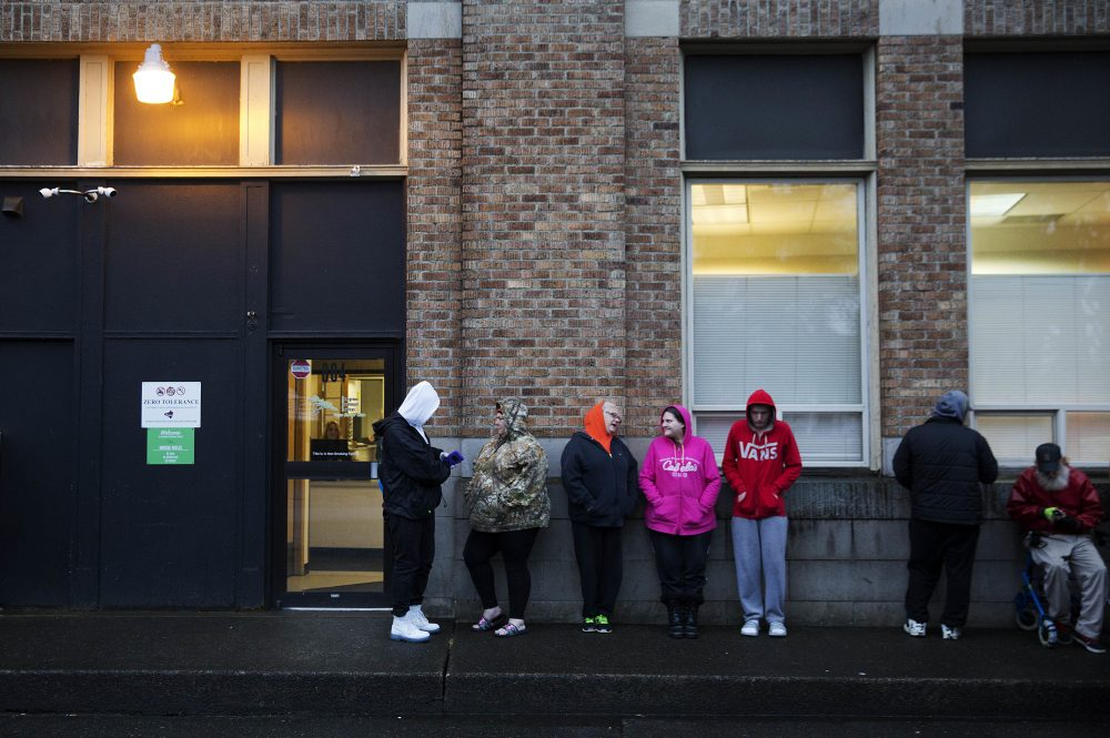 People wait in line for the Evergreen Treatment Services methadone clinic to open in Hoquiam, Wash., Thursday, June 15, 2017. (David Goldman/AP)
