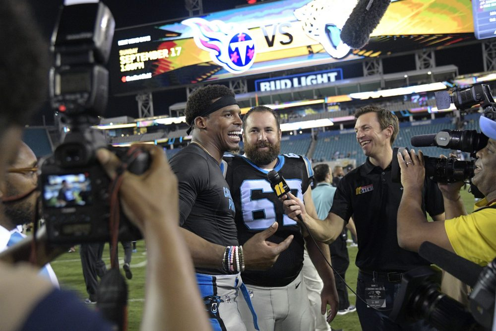 Carolina Panthers quarterback Cam Newton talks to reporters on the field after an NFL preseason football game against the Jacksonville Jaguars, Thursday, Aug. 24, 2017, in Jacksonville, Fla. (Phelan M. Ebenhack/AP)