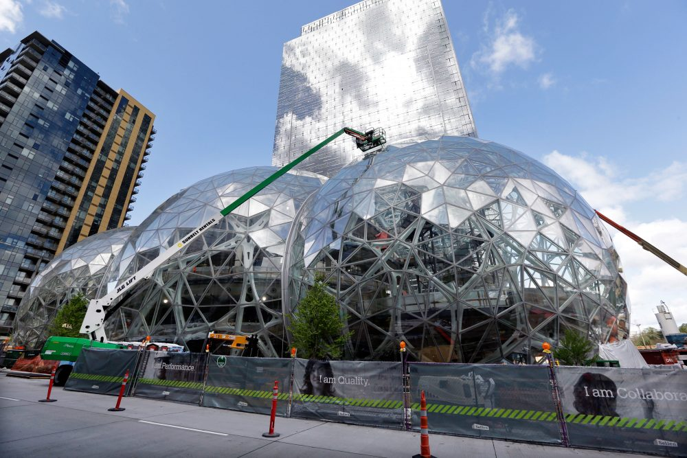 In this April 27 file photo, construction continues on three large domes as part of an expansion of the Amazon campus in downtown Seattle. Amazon has said it will spend more than $5 billion to build another headquarters in North America to house as many as 50,000 employees. (Elaine Thompson/AP)