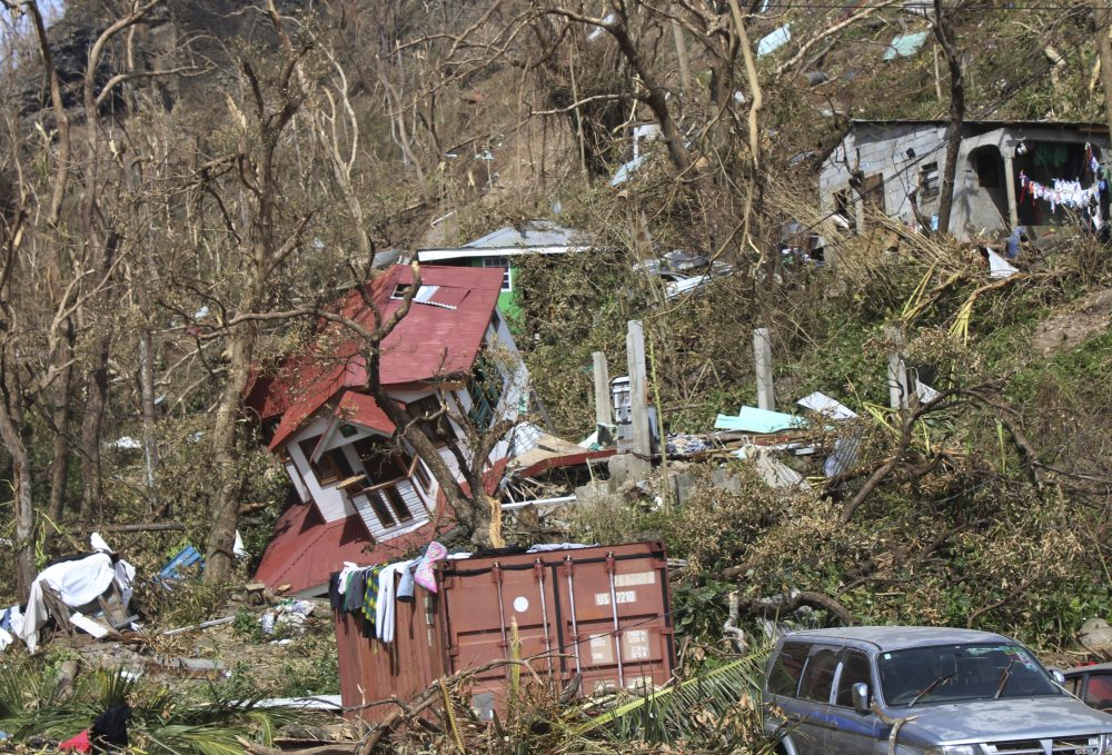 In this Sept. 23 photo, homes lay scattered after the passing of Hurricane Maria in Roseau, the capital of the island of Dominica. (Carlisle Jno Baptiste/AP)