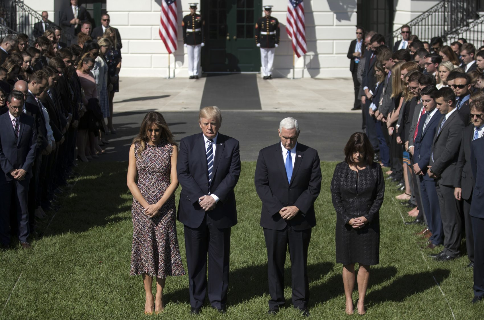 President Donald Trump and first lady Melania Trump stand with Vice President Mike Pence, his wife Karen and members of the White House staff, during a moment of silence to remember the victims of the mass shooting in Las Vegas, on the South Lawn of the White House in Washington, Monday, Oct. 2, 2017. (Carolyn Kaster/AP)