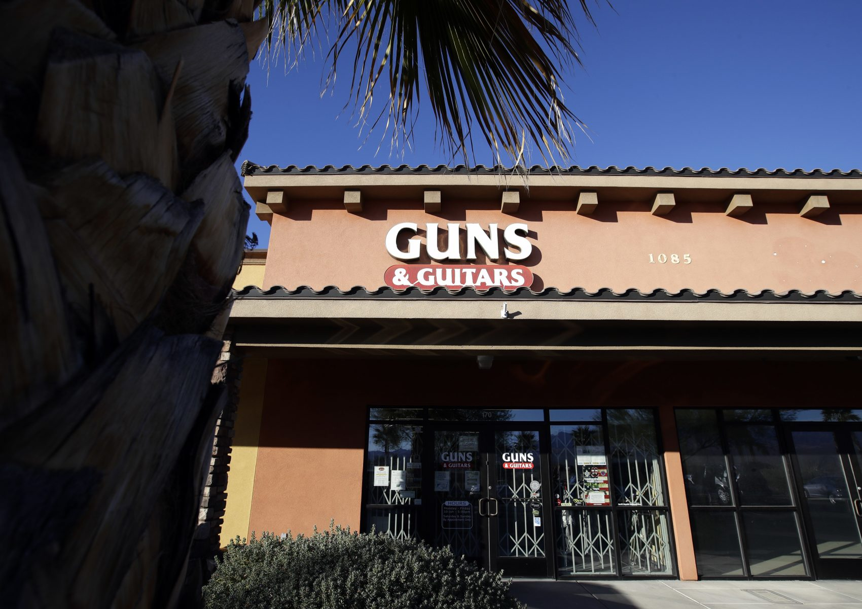 The Guns & Guitars store is shown in Mesquite, Nev., Monday, Oct. 2, 2017. The store's general manager Christopher Sullivan said in a statement Monday that Stephen Craig Paddock showed no signs of being unfit to buy guns. Paddock killed dozens and injured hundreds Sunday night when he opened fired at an outdoor country music festival in Las Vegas. (Chris Carlson/AP)