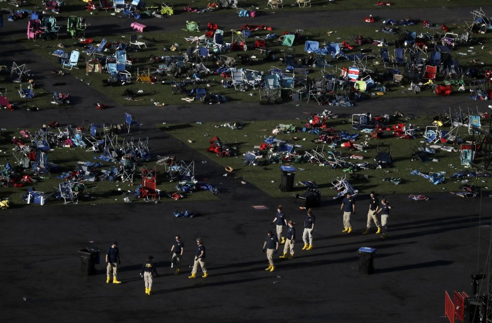 Investigators work at a festival grounds across the street from the Mandalay Bay Resort and Casino on Oct. 3 in Las Vegas. (Marcio Jose Sanchez/AP)