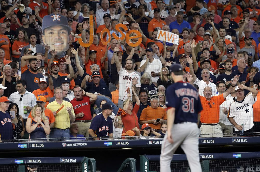 Fans react as Boston Red Sox starting pitcher Drew Pomeranz (31) is pulled from the game during the third inning in Game 2 of baseball's American League Division Series against the Houston Astros, Friday, Oct. 6, 2017, in Houston. (AP Photo/David J. Phillip)