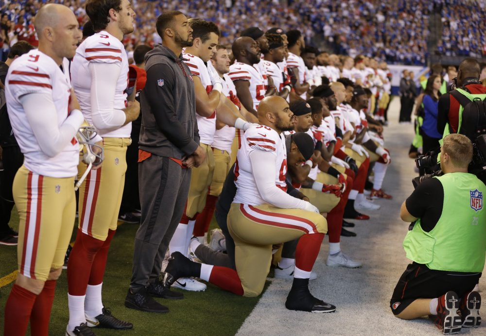 Members of the San Francisco 49ers kneel during the playing of the national anthem before an NFL football game against the Indianapolis Colts, Sunday, Oct. 8, 2017, in Indianapolis. Vice President Mike Pence left the 49ers-Colts game after about a dozen San Francisco players took a knee during the national anthem Sunday. (Michael Conroy/AP)