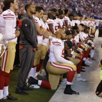 9fd304ab8 Members of the San Francisco 49ers kneel during the playing of the national  anthem before an