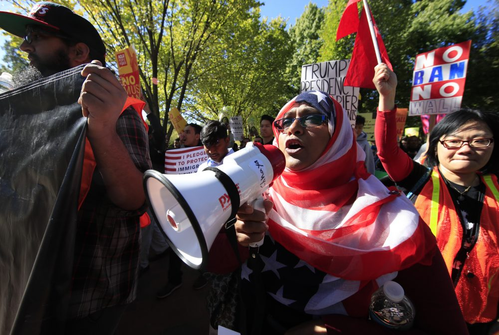 "American Hoshneara Begum, center, Bangladeshi descent, leads the chant of slogans against what they call a ""Muslim ban"" as she and others march from Lafayette Square to the Trump International Hotel in Washington, Wednesday, Oct. 18, 2017. (Manuel Balce Ceneta/AP)"