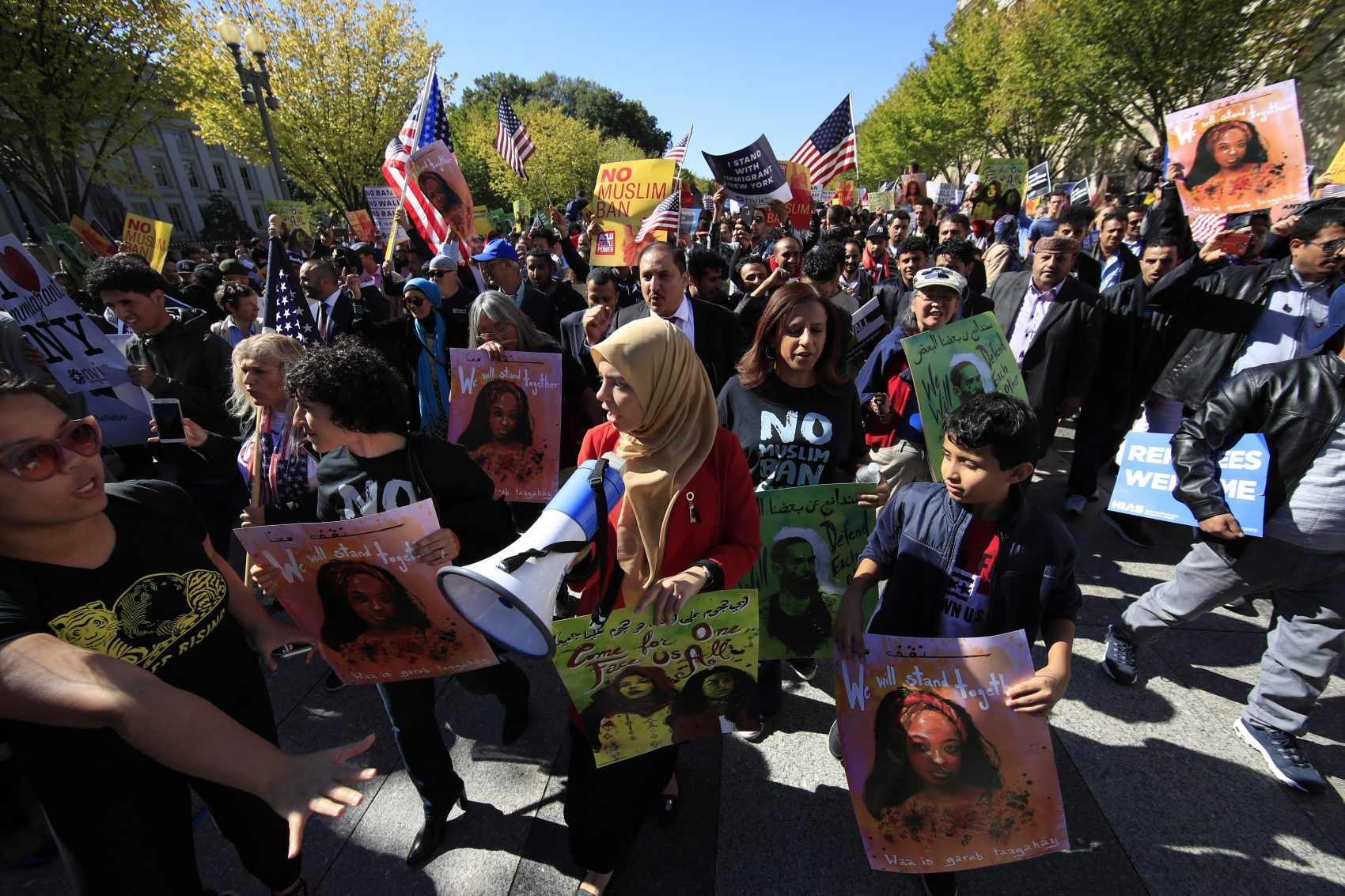 """Muslim, civil rights groups and their supporters gather at a rally against what they call a """"Muslim ban"""" in front of the White House in Washington, Wednesday, Oct. 18, 2017. (Manuel Balce Ceneta/AP)"""