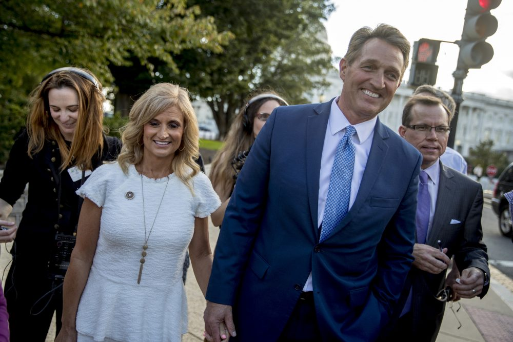 Sen. Jeff Flake, R-Ariz., accompanied by his wife Cheryl, leaves the Capitol in Washington, Tuesday, Oct. 24, 2017, after announcing he won't seek re-election in 2018. (Andrew Harnik/AP)