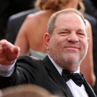 Harvey Weinstein arrives at the Oscars on Sunday, Feb. 22, 2015, at the Dolby Theatre in Los Angeles. Weinstein was fired after a bombshell New York Times report published Oct. 8 detailed decades of sexual harassment accusations and settlements against the film producer. (Vince Bucci/Invision/AP)