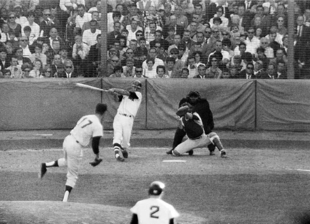 Boston Red Sox slugger Carl Yastrzemski hits a three run homer in a game at Fenway Park, September 30, 1967. (AP)
