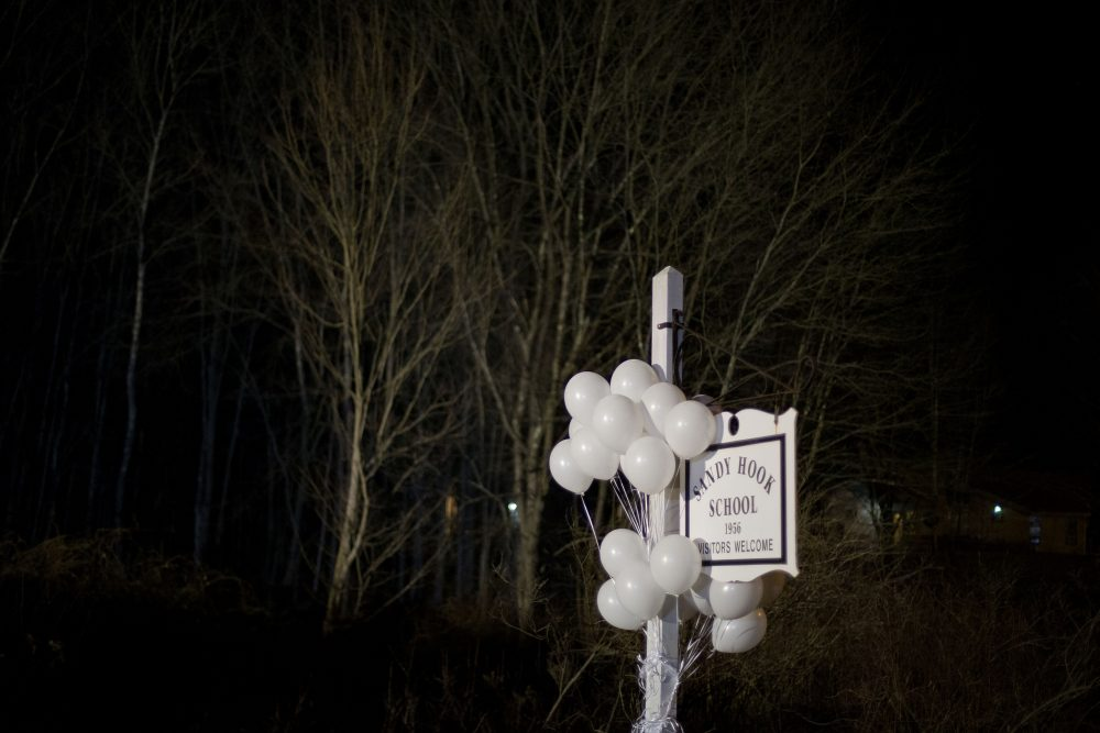 White balloons decorate the sign for the Sandy Hook Elementary School, on Dec. 15, 2012. (David Goldman/AP)