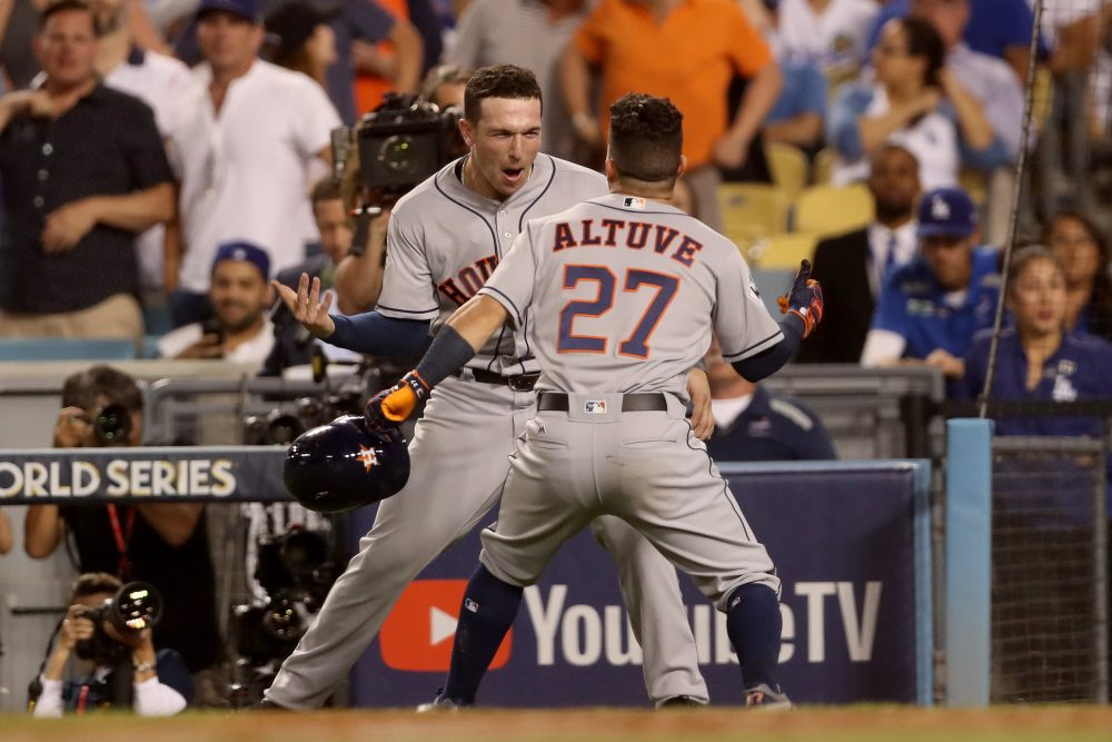 Jose Altuve and Alex Bregman of the Houston Astros celebrate during the tenth inning of Game 2.  (Christian Petersen/Getty Images)