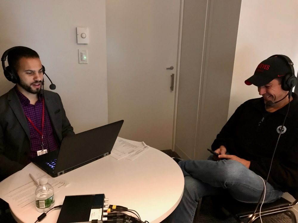Season Ticket host, Chris Gasper (L), records an episode of the podcast with NFL Reporter Albert Breer (R).