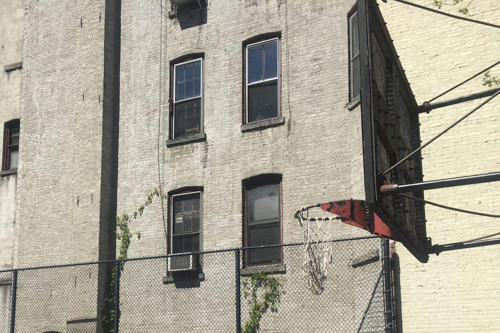Some New Yorkers think the city's broken rims contribute to a grittier style of play. (Martin Kessler/Only A Game)