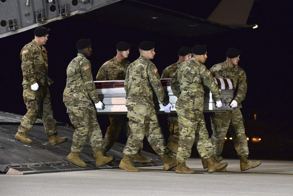 A U.S. Army team transfers the remains of Army Staff Sgt. Dustin Wright upon arrival at Dover Air Force Base, Del.  (Staff Sgt. Aaron J. Jenne/U.S. Air Force via AP)