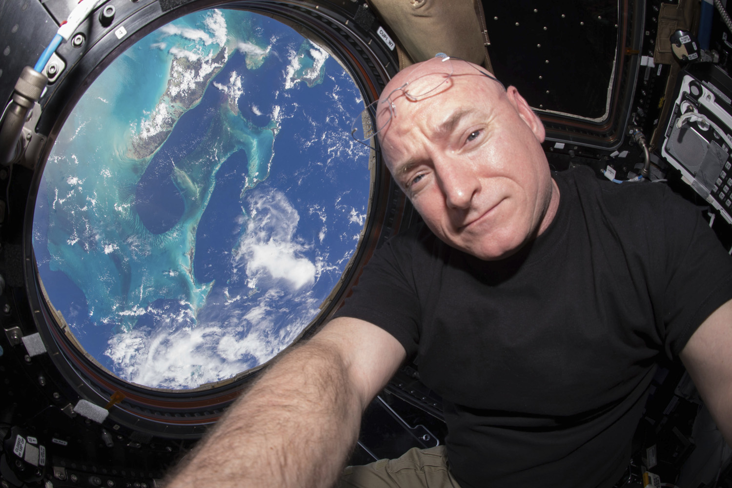 Astronaut Scott Kelly takes a photo of himself inside the International Space Station in 2015. (Scott Kelly/NASA via AP)