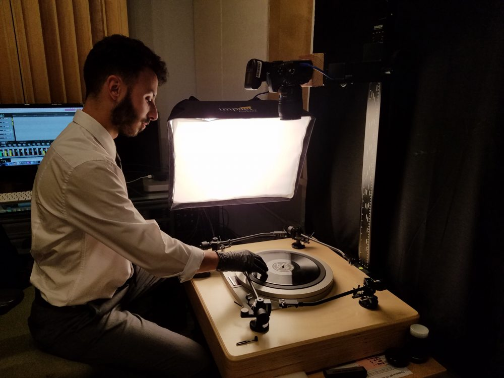 A technician uses a 4-arm 78 turntable to digitize a vinyl record at a facility in Philadelphia. (Courtesy Internet Archive)