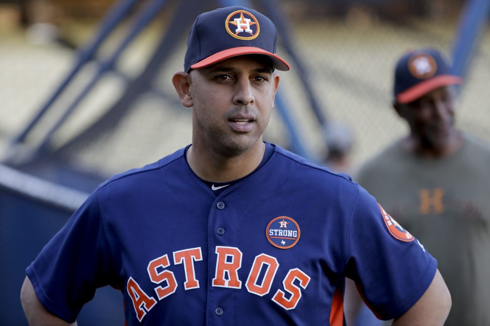 Houston Astros bench coach Alex Cora watches batting practice during media day for baseball's World Series against the Los Angeles Dodgers Monday, Oct. 23, 2017, in Los Angeles. (AP Photo/David J. Phillip)