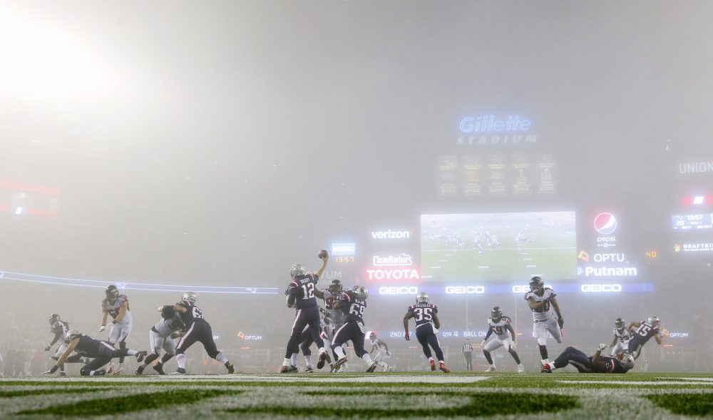 New England Patriots quarterback Tom Brady throws in the fog against the Atlanta Falcons during an NFL football game at Gillette Stadium in Foxborough, Mass. Sunday, Oct. 22, 2017. (Winslow Townson/AP Images for Panini)
