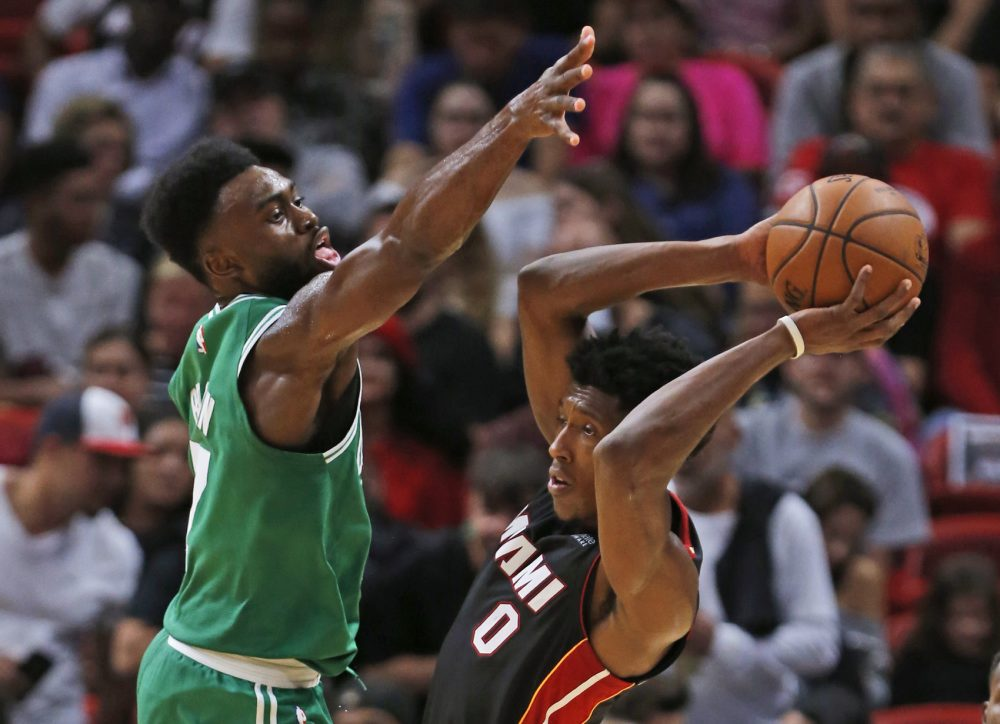 Miami Heat guard Josh Richardson (0) looks for an open teammate past Boston Celtics forward Jaylen Brown (7) during the second half of an NBA basketball game, Saturday, Oct. 28, 2017, in Miami. The Celtics defeated the Heat 96-90. (AP Photo/Wilfredo Lee)