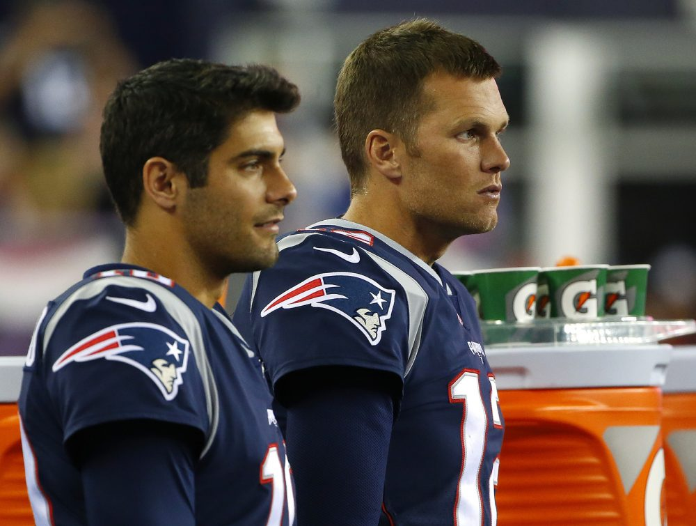 New England Patriots quarterback Tom Brady, right, and quarterback Jimmy Garoppolo look on during the second half of an NFL preseason football game against the New York Giants, Thursday, Aug. 31, 2017, in Foxborough, Mass. (AP Photo/Winslow Townson)
